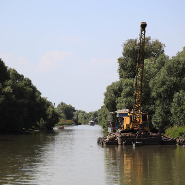 """""""Sand dredger in order to keep the navigation channel for boats, Danube Delta..."""" stock image"""