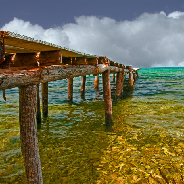 """""""Wooden jetty extending out to sea"""" stock image"""