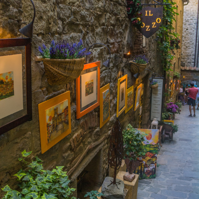 """Cortona street with pictures on external wall"" stock image"