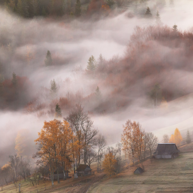"""Mountain village in clouds of fog and smoke in the autumn mornin"" stock image"