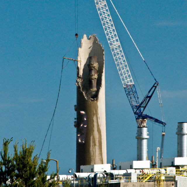 """""""A redundant chimney stack being demolished by the nibbling proce"""" stock image"""