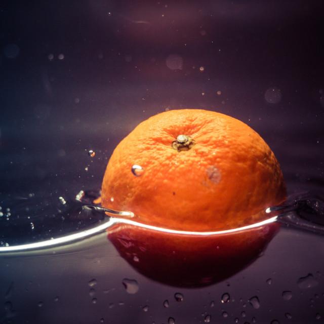 """Orange in water"" stock image"