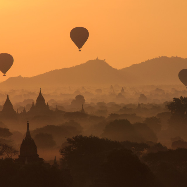 """Watching the hot air balloons over the Bagan temples at sunrise"" stock image"