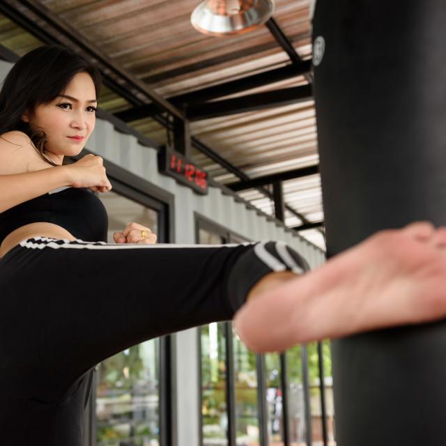 """Beautiful girl practice Muay Thai boxing"" stock image"