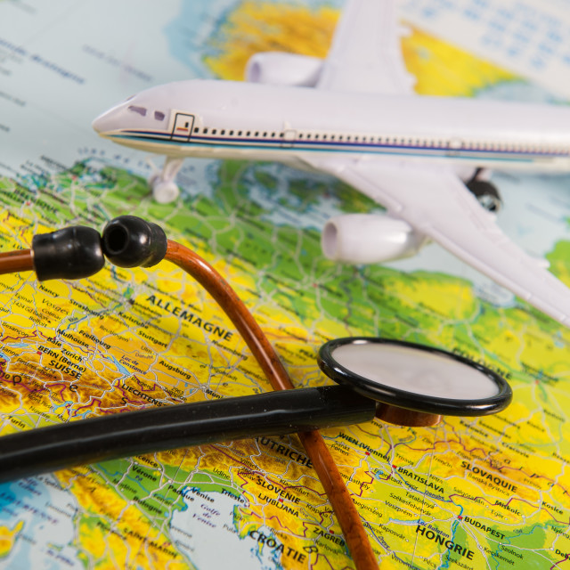 """Stethoscope on map medical concept tourism travel care"" stock image"