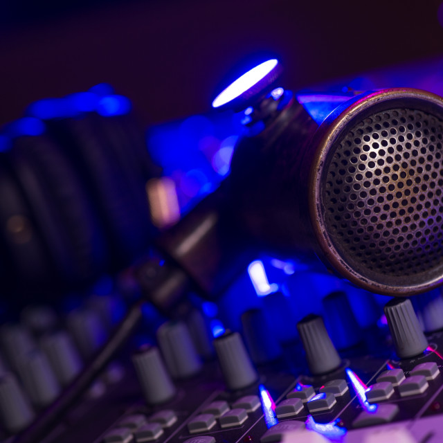 """""""Vintage Microphone and Headphones on dirty sound mixer panel"""" stock image"""