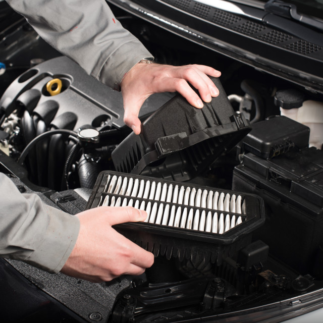 """changing the air filter on car"" stock image"