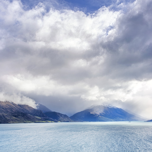 """Pigeon Island - Wawahi Waka in the distance of Lake Wakatipu, near Queenstown, New Zealand"" stock image"