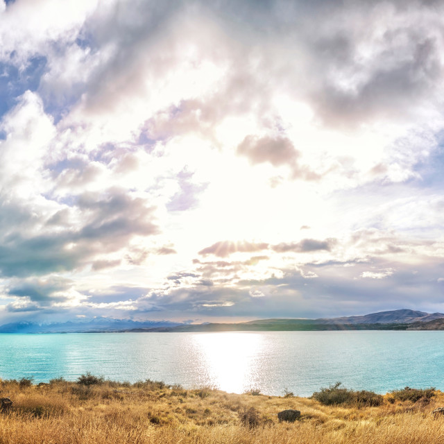 """Early morning sun over turquoise Lake Pukaki, New Zealand"" stock image"