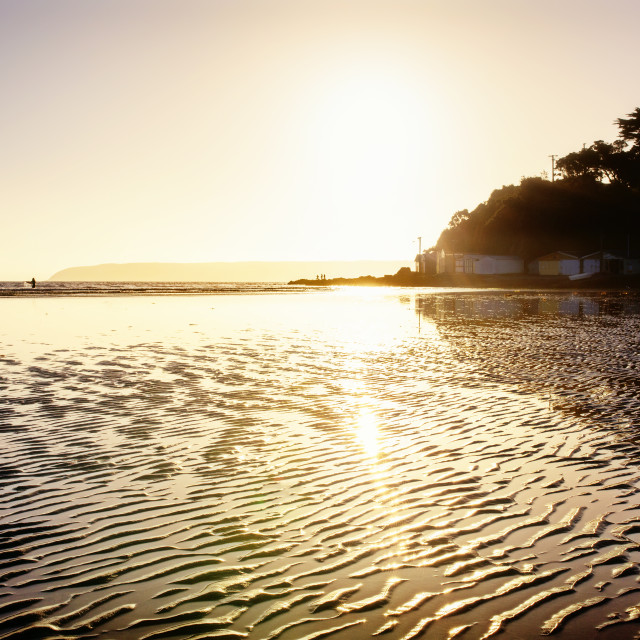 """Copper rippled beach at sunset, Titahi Bay, New Zealand"" stock image"