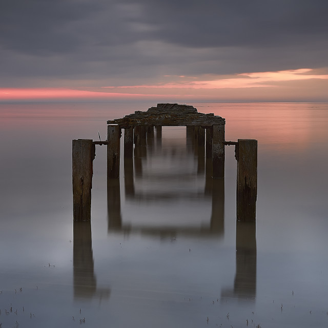 """Dusk with the old groynes"" stock image"