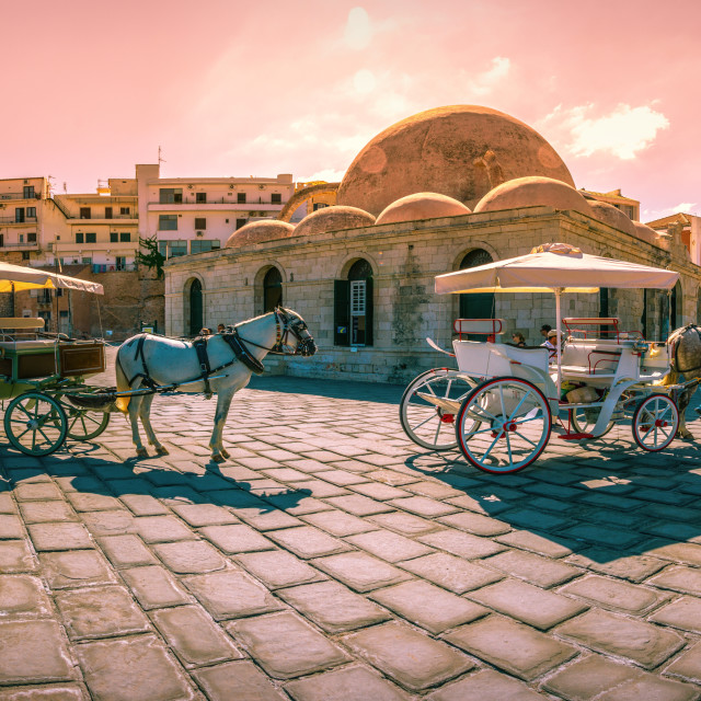 """Panorama of the old harbor of Chania with horse carriages and mosque, Crete, Greece."" stock image"