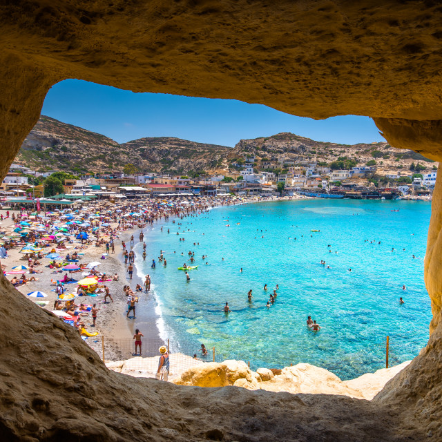 """Matala beach with caves on the rocks that were used as a roman cemetery and at the decade of 70's were living hippies from all over the world, Crete, Greece"" stock image"