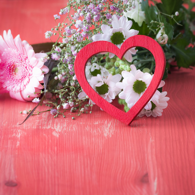 """""""Red heart leaned on flowers"""" stock image"""