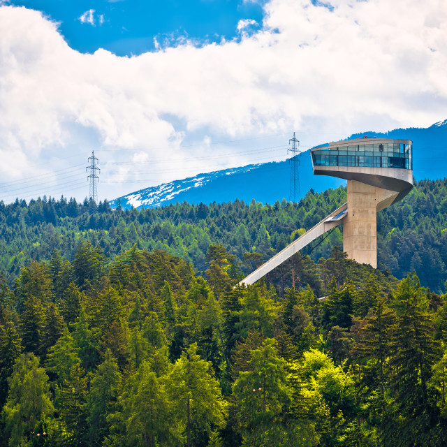 """Alpine hills of Insbruck and olympic ski jump tower view"" stock image"
