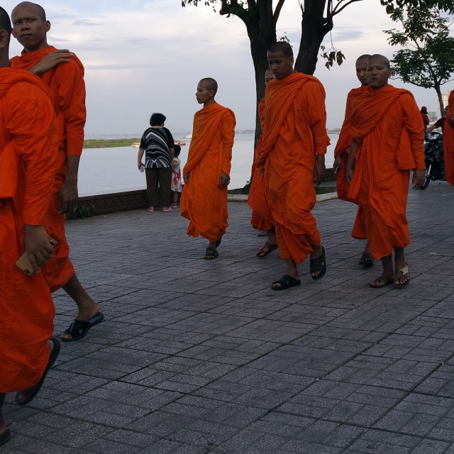 """Monks by the river."" stock image"