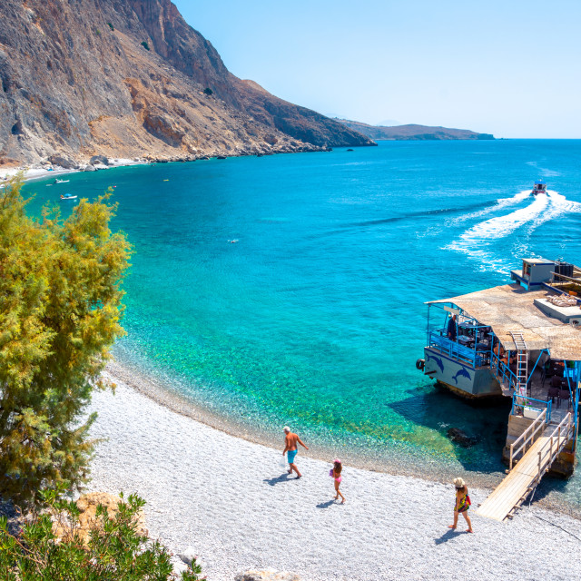 """""""Glyka Nera beach (Sweet Water or Fresh Water). View of the remote and famous Sweet Water Beach in south Crete, with its unique tavern on the rock inside sea. This is a nudist beach."""" stock image"""