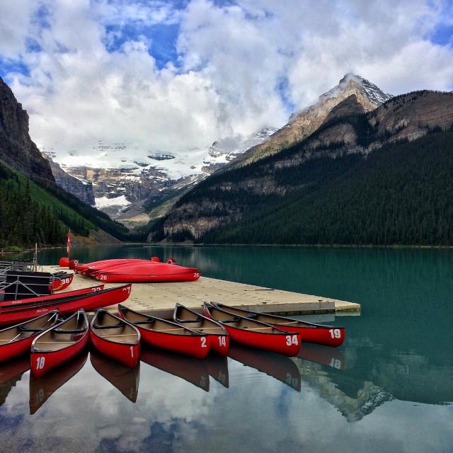 """""""Canoes on Lake Louise"""" stock image"""