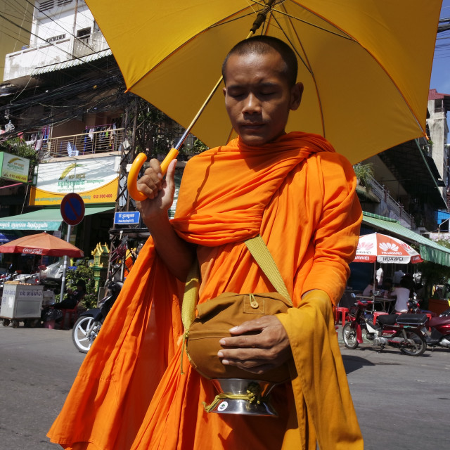 """Monk with umbrella."" stock image"