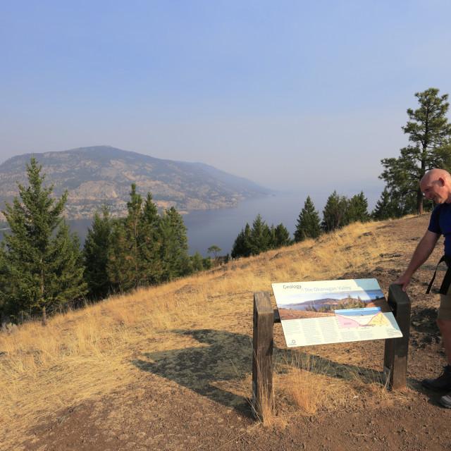 """Walker on Knox Mountain natural park, Kelowna City, Okanagan region, British..."" stock image"