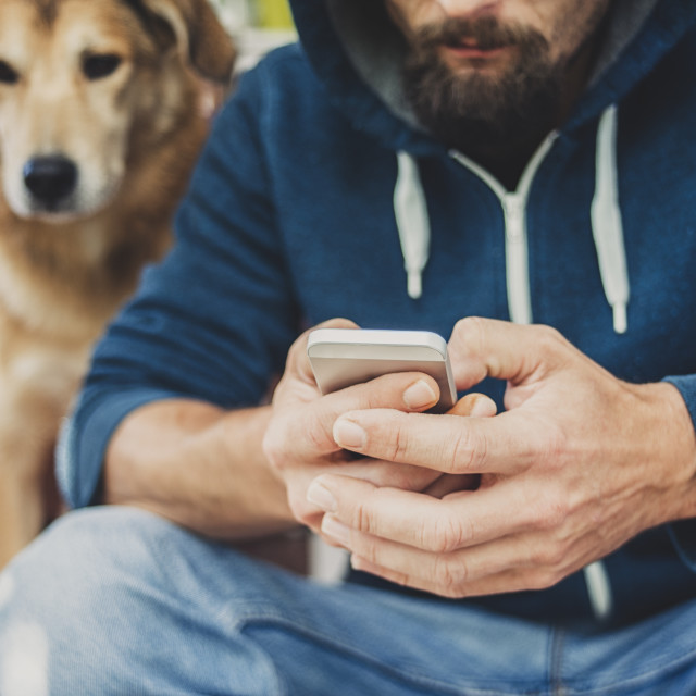 """Man, dog and phone"" stock image"