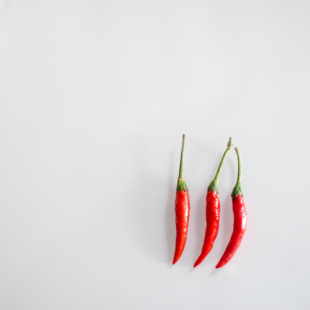 """Three red chillies"" stock image"