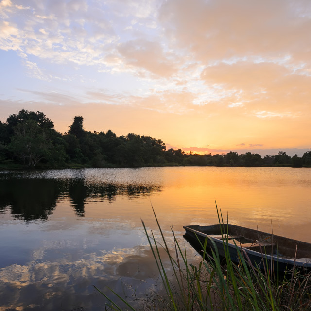 """""""Sunset on the lake with a boat"""" stock image"""