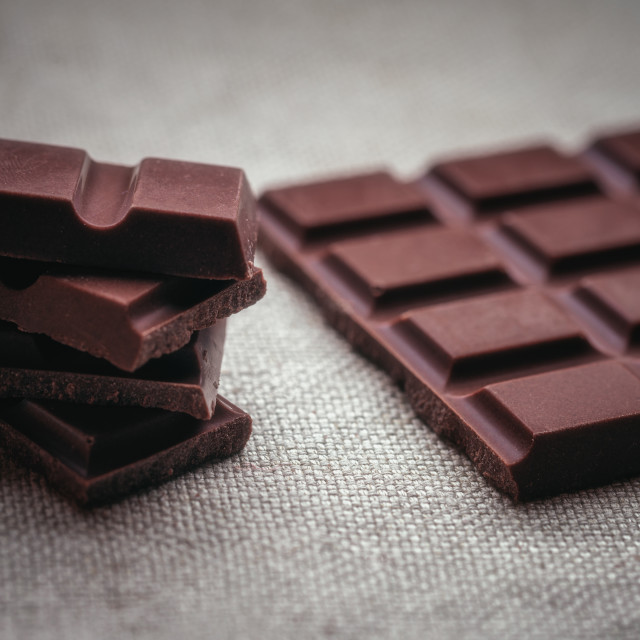 """""""Dark chocolate and background texture of old jute"""" stock image"""