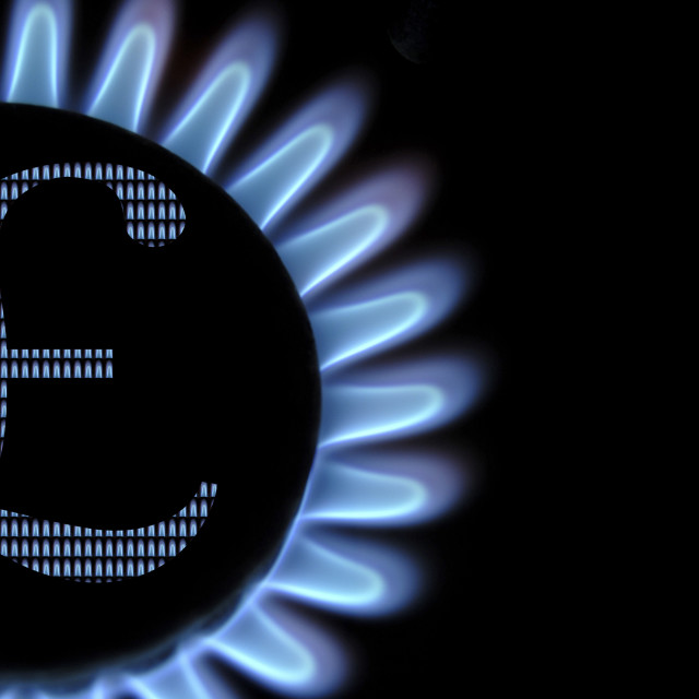 """Gas hob flames with UK pounds currency symbol, concept household bills."" stock image"