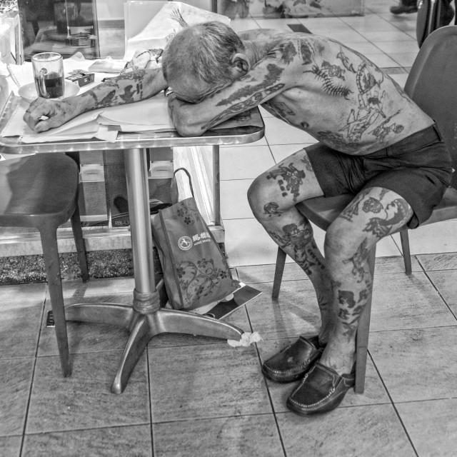 """Tattooed man | Singapore"" stock image"