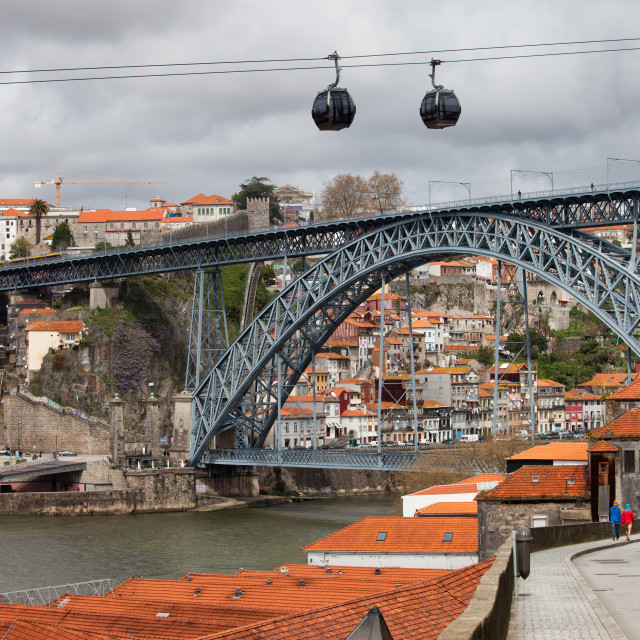 """Dom Luis I Bridge in Porto and Cable Car in Gaia"" stock image"