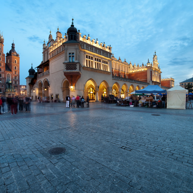 """Main Square in the Old Town of Krakow in Poland at Dusk"" stock image"
