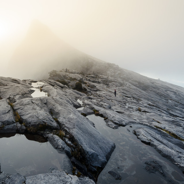 """""""Barren rocky slopes and ponds of water on Mount Kinabalu, a volcano in..."""" stock image"""