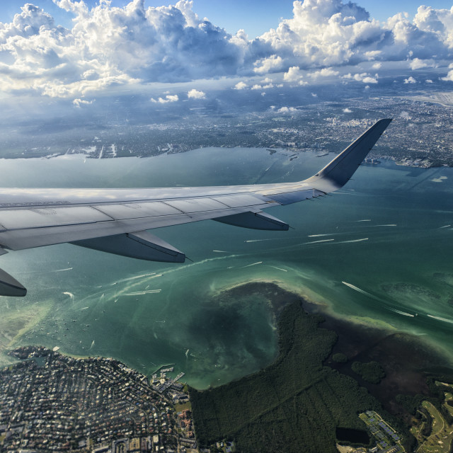 """Wing dip over Miami"" stock image"