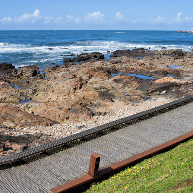 """Wooden Promenade Along the Ocean in Porto"" stock image"