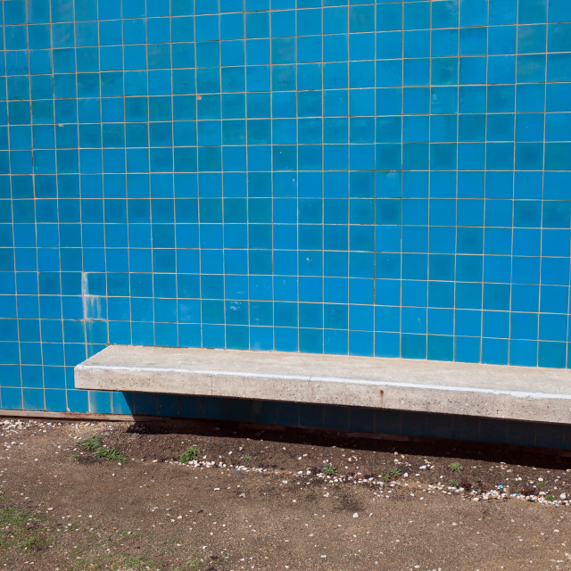 """Blue Tiles Wall with Bench"" stock image"