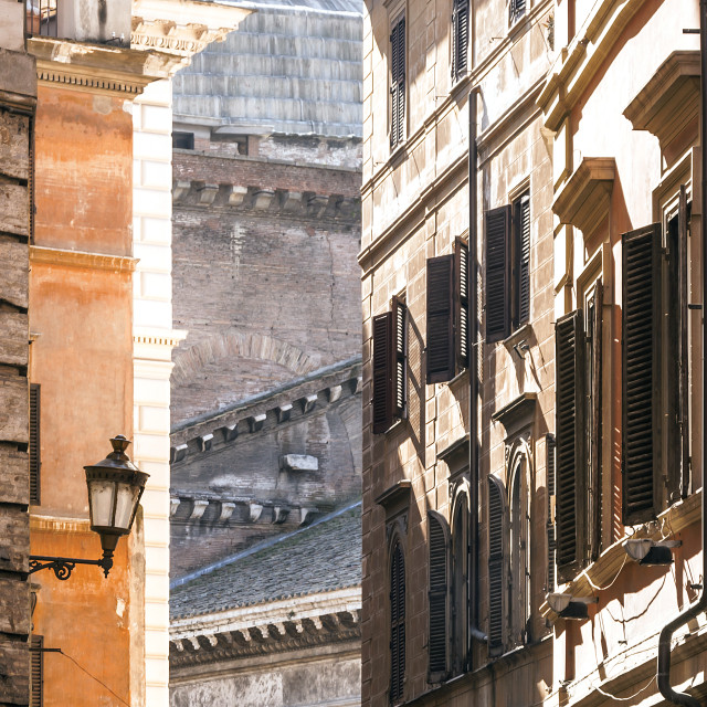 """Old city lamp in a small alley in Rome"" stock image"