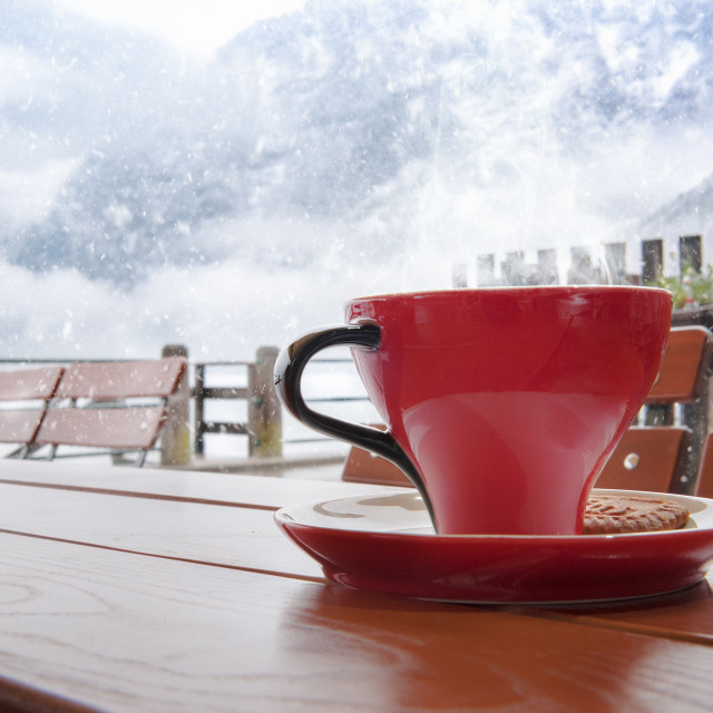 """Hot coffe on a snowy day"" stock image"