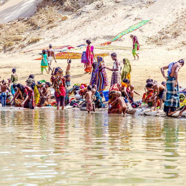 """Washing on River Bank Jaflong"" stock image"