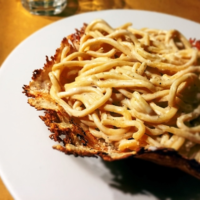 """typical roman pasta with cacio e pepe (cheese and pepper) sauce"" stock image"