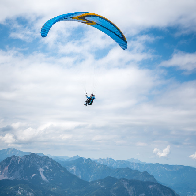 """Man paragliding on Hoher Dachstein mountains"" stock image"