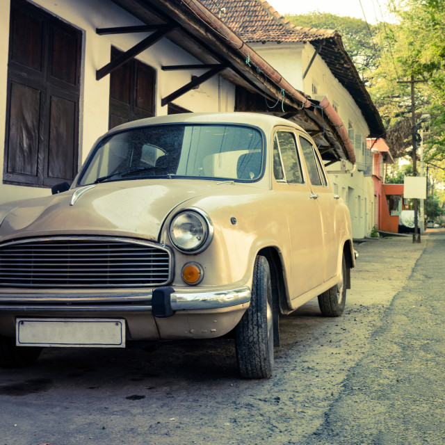 """Vintage retro car (no brand) parked in a street"" stock image"