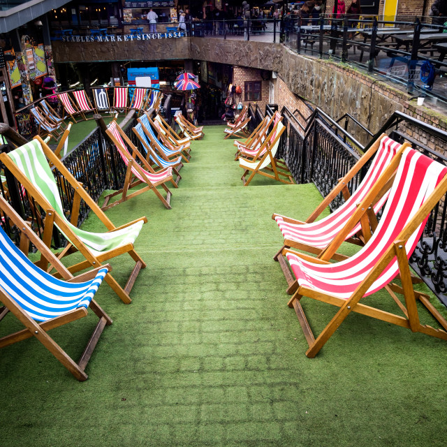 """Loungers in Camden Market in London"" stock image"