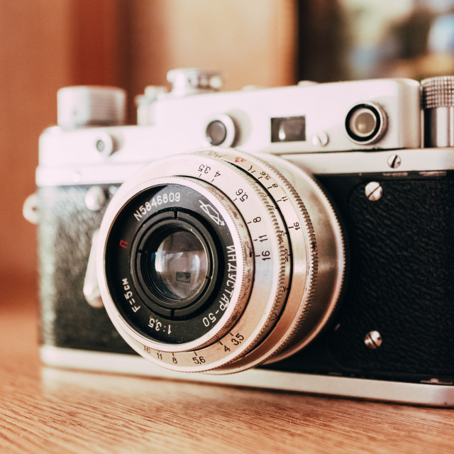 """Vintage Film Camera Is On Wooden Shelf At Home"" stock image"