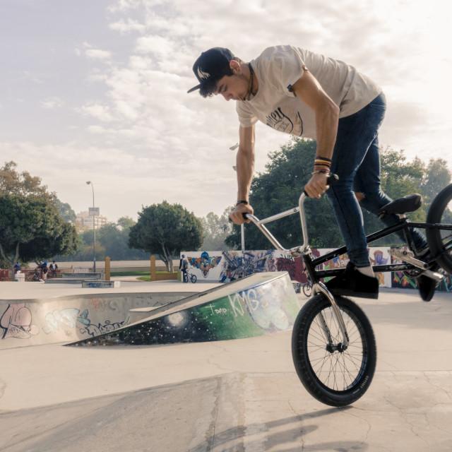 """BMX rider at skatepark."" stock image"