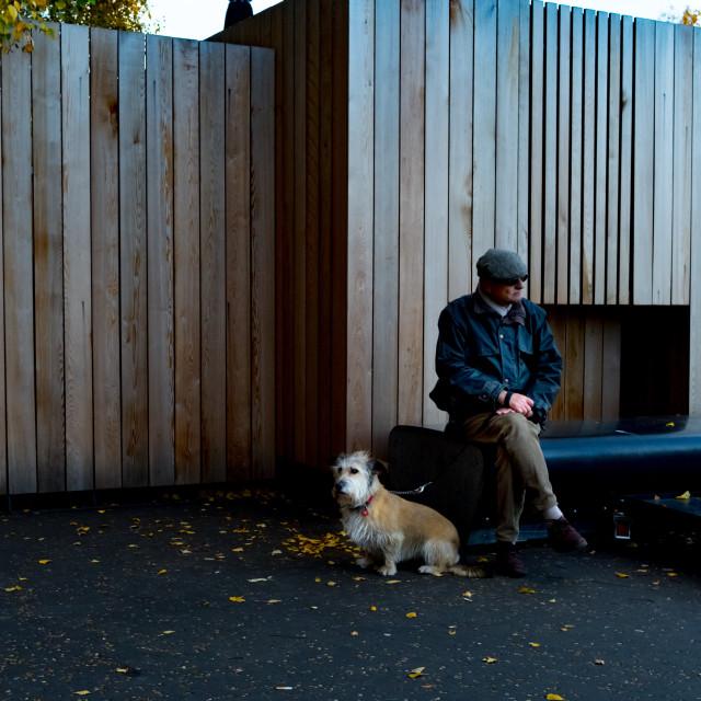 """Man and dog outside Tate Modern"" stock image"