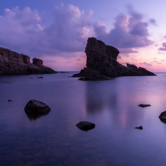 """Rocks in the sea"" stock image"