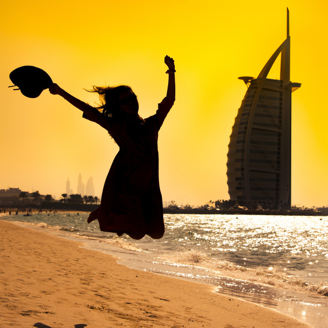 """Happy girl at the famous beach in Dubai"" stock image"
