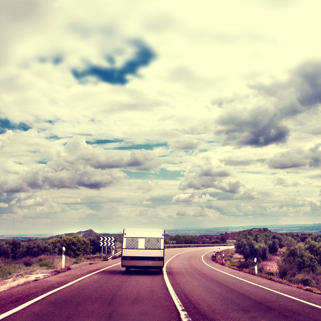 """""""Caravan lifestyle road and landscape in vintage old style."""" stock image"""