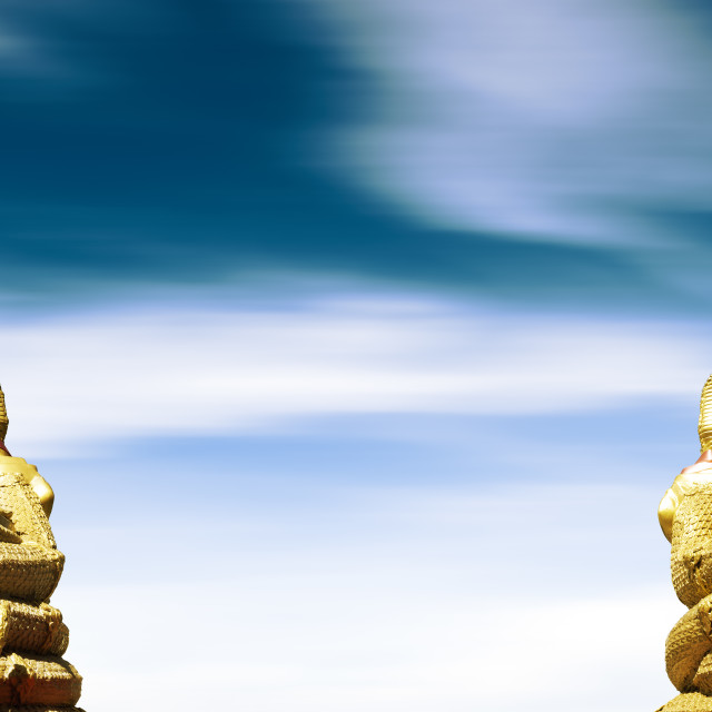 """golden buddha on blue sky.Meditation concept"" stock image"